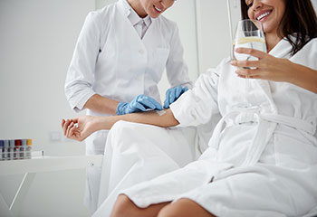 Woman Receiving IV Therapy
