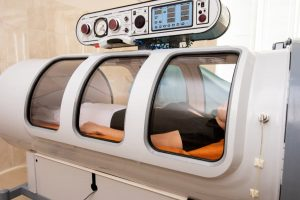 woman lying in a hyperbaric oxygen chamber